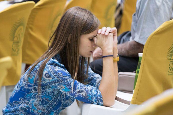 Brazil: Rio de Janeiro, Brazil :: Yulia Lyagutskaya (Russia) prays for the least reached at a prayer event. More Info