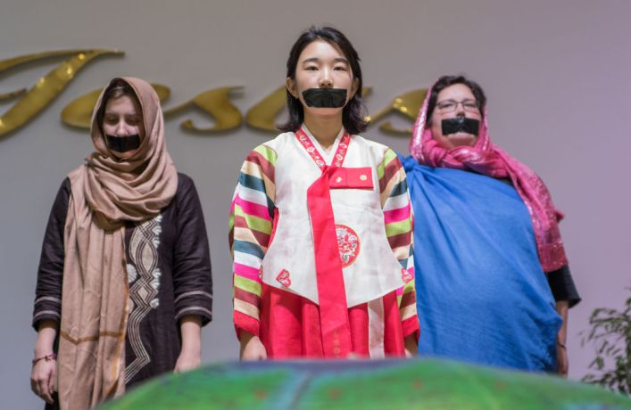 Brazil: Rio de Janeiro, Brazil :: Alena Didio (Germany), Hanna Kim (South Korea) and Julia Kostner (Germany) stand on stage to represent the least reached at a prayer event. More Info