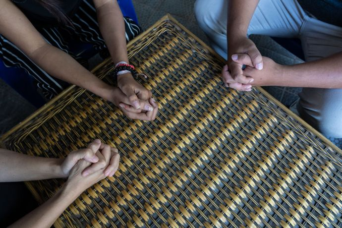 South East Asia: Group of people praying together. Photo by Achim Schneider. More Info