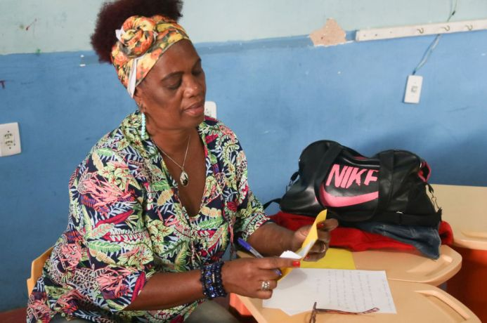 Brazil: Vitoria, Brazil :: A woman writes a letter to her children. More Info