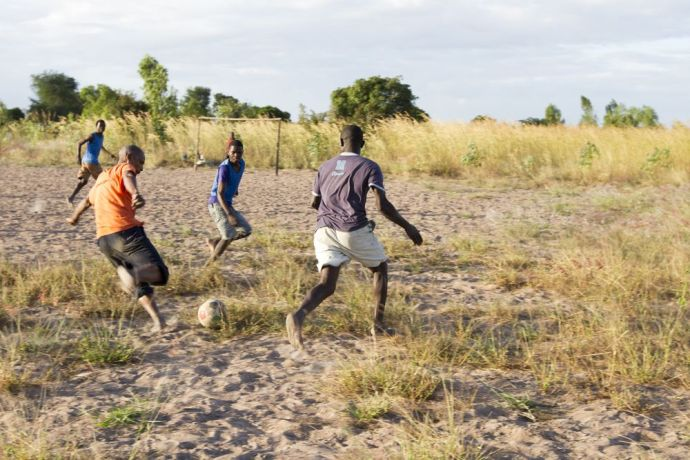 Malawi: People play football in Malawi. Photo by Rebecca Rempel. More Info