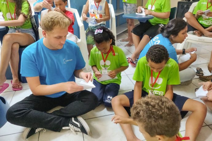 Brazil: Salvador, Brazil :: Liam Greenan (United Kingdom) teaches children to share their faith creatively. More Info