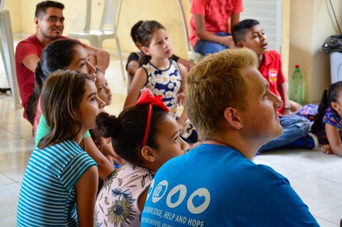 Brazil: Belém, Brazil :: Liam Greenan (United Kingdom) listens to a crewmember giving an English class. More Info