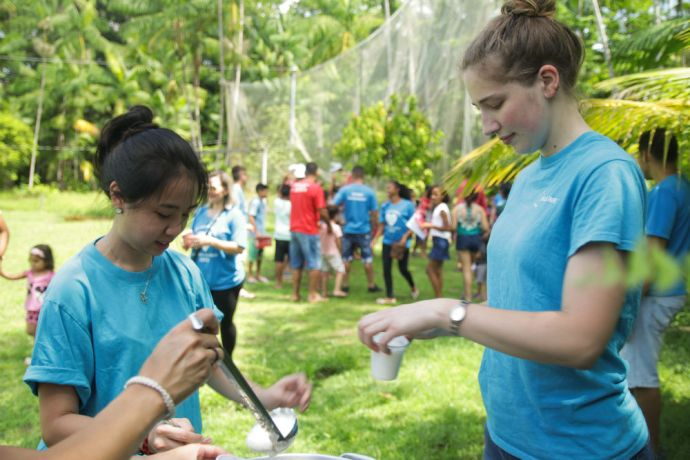Brazil: Belém, Brazil :: Mercy Chen (Taiwan) and Annelie Menges (Germany) prepare drinks for a community that lives along a river. More Info