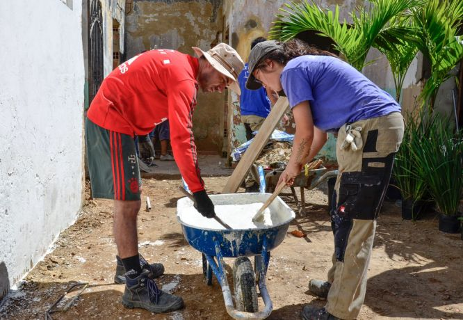 Brazil: Salvador, Brazil :: Juan Nunez (Chile) and Britt So (Canada) make cement for a building project. More Info