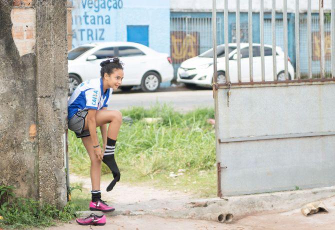 Brazil: Belém, Brazil :: A girl from an underprivileged area of Belém puts on her shoes. More Info