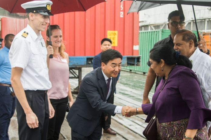 Guyana: Georgetown, Guyana :: Pil-Hun Park (South Korea) welcomes the prime minister and his wife on the quayside. More Info