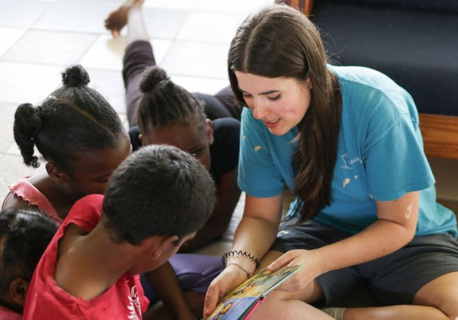 Guyana: Georgetown, Guyana :: Alba Nadal (Spain) reads a book to children. More Info