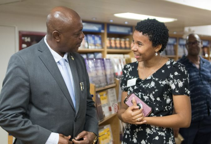 Saint Vincent & the Grenadines: Kingstown, Saint Vincent and the Grenadines :: Fiyah King (Saint Vincent) chats to a government minister at the bookfairs official opening in her island. More Info