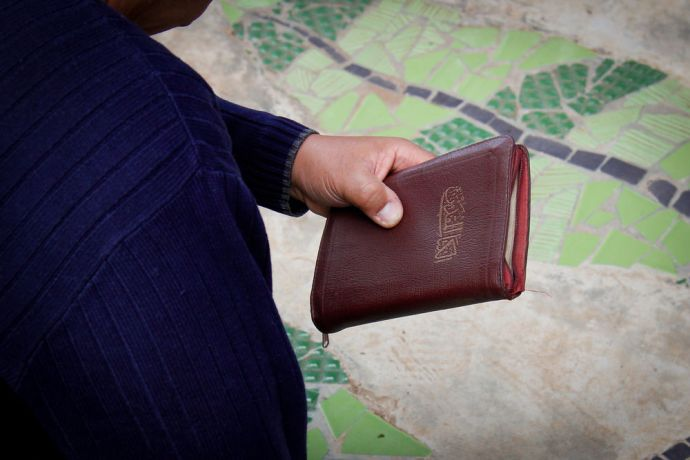 North Africa: A worker holds an Arabic Bible, the language spoken in the area he serves in. Photo by Johanna Bird. More Info