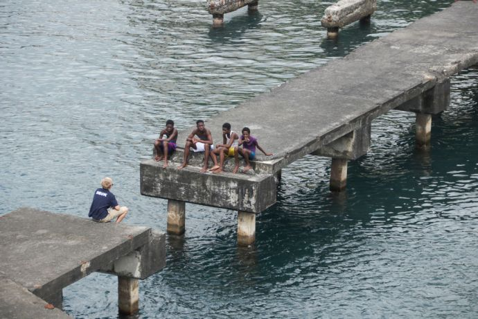 Saint Vincent & the Grenadines: Kingstown, Saint Vincent and the Grenadines :: Liam Packwood (Scotland) chats with teenagers on the quayside. More Info