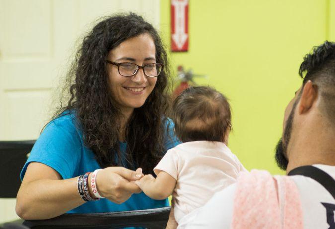 Trinidad & Tobago: Port of Spain, Trinidad and Tobago :: Katia Bodareva (Moldova) plays with a baby at a local clinic. More Info