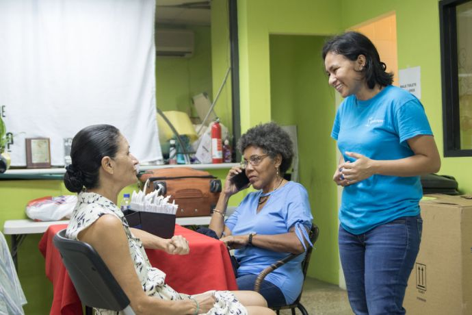 Trinidad & Tobago: Port of Spain, Trinidad and Tobago :: Vianey Marcelo Martinez (Mexico) chats with a patient at a local clinic. More Info