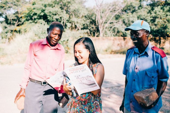 Zambia: Ivy, from Taiwan, speaking in a village at Lake Tanganyika. Photo by Doseong Park. More Info
