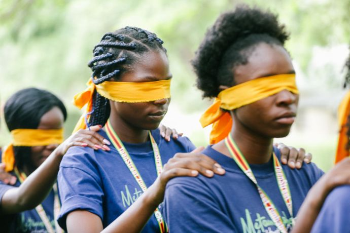 Zimbabwe: Teens going through a trust activity as they learned about trusting God More Info