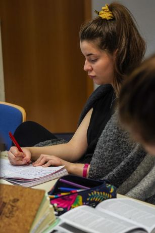 Germany: A Mission Discipleship Training (MDT) Love Europe student takes notes during a training session. Photo by Achim Schneider. More Info
