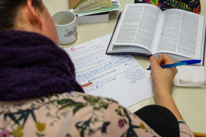 Germany: Mission Discipleship Training (MDT) Love Europe student studies the Bible during a training session. Photo by Achim Schneider. More Info