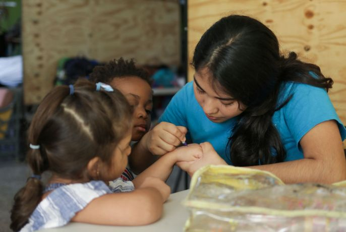 Trinidad & Tobago: Port of Spain, Trinidad and Tobago : Dani Severiano (Mexico) connects with children. More Info