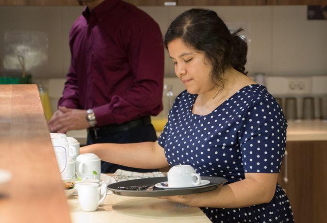 Trinidad & Tobago: Port of Spain, Trinidad and Tobago :: Valeria Balderas (Mexico) prepares tea at an event. More Info