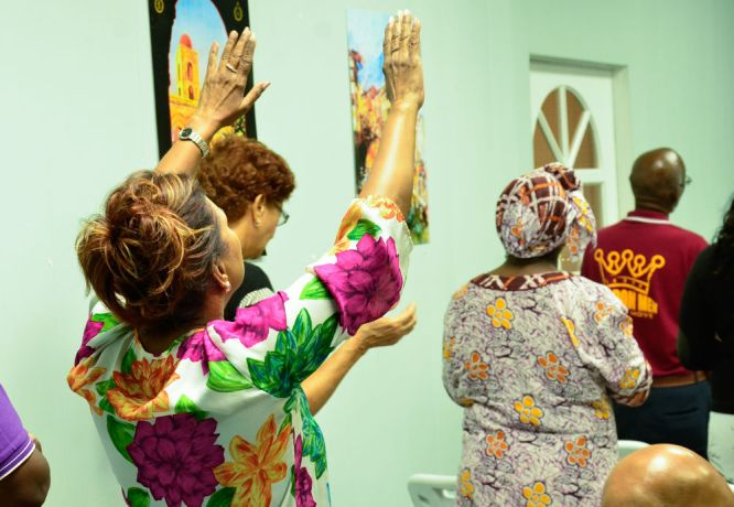 Barbados: Bridgetown, Barbados :: A woman woships in a prayer event. More Info