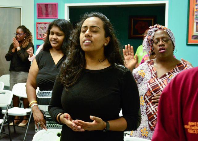 Barbados: Bridgetown, Barbados :: Rujuni Bhakar (United Kingdom) prays at a prayer event. More Info