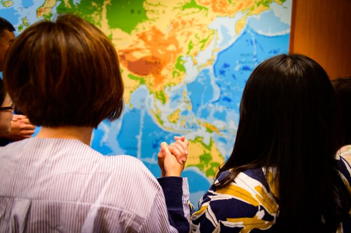 Hong Kong: Staff workers pray over Asia. More Info