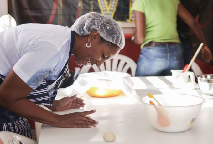 Barbados: Bridgetown, Barbados :: A woman enjoys learning how to bake at a session run by crewmembers at the Ammar Empowerment centre. More Info