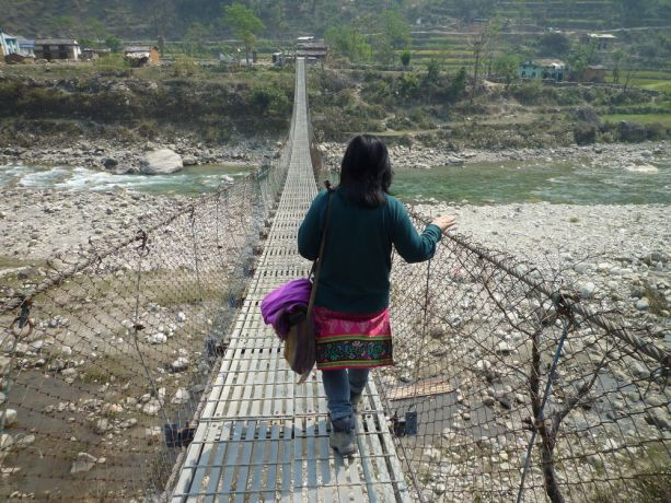 Russia: A Russian woman crossing a bridge to share the Gospel in South-East Asia. More Info