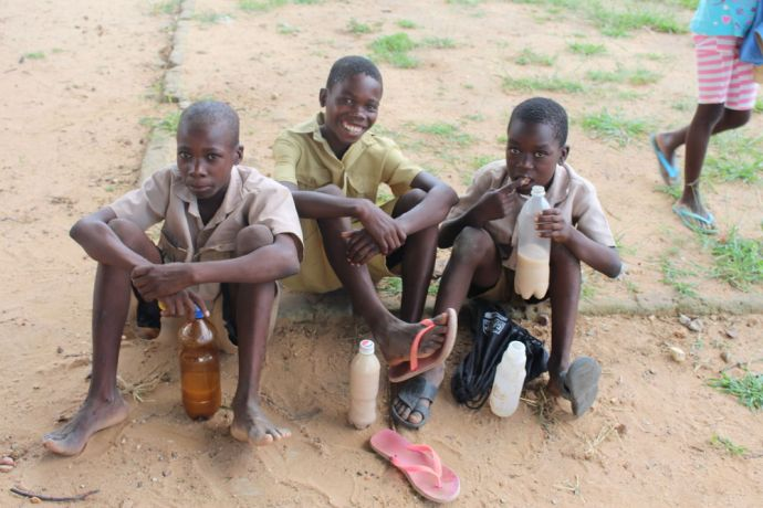Zimbabwe: Schoolboys enjoy a drink of Mahewu in drought ravaged Zimbabwe. A bottle of Mahewu provides relief to school children. More Info