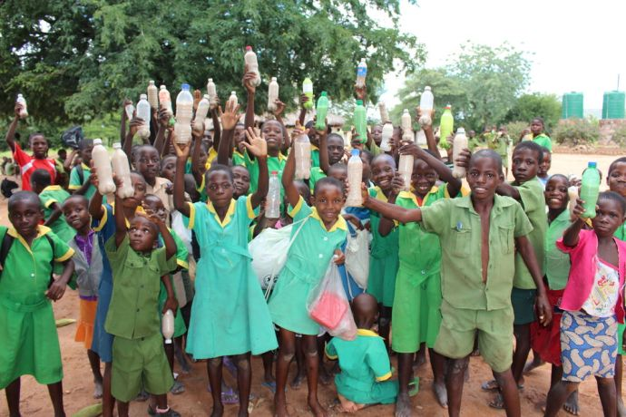 Zimbabwe: School-children from Mulambe Primary School proudly displays their Mahewu drink as they head home after school  to share the drink with their family. More Info