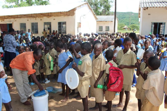 Zimbabwe: Pupils queue to get their 500ml of the tasty Mahewu at Siabuwa Primary school in drought-ridden Zimbabwe. This is often the only meal that the child will have. More Info