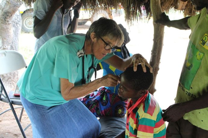 Zimbabwe: An OM nurse examines a patient at one of her mobile clinics. Vicky works among the Tonga people of Zimbabwe. More Info