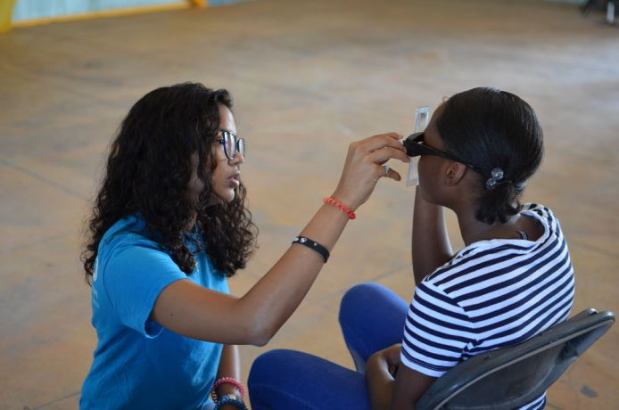 Jamaica: Kingston, Jamaica :: A crewmember tests people for reading glasses. More Info