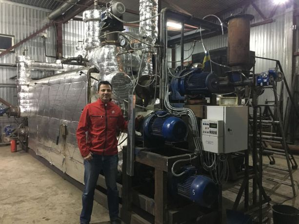 Ukraine: Wayne Zschech stands next to pyrolysis equipment, which is used to turn waste plastic into usable fuel. More Info