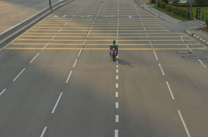 Malaysia: An almost entirely empty street in Kuala Lumpur, Malaysia during rush hour shows the countrys lockdown measures in action to prevent the spread of COVID-19. More Info