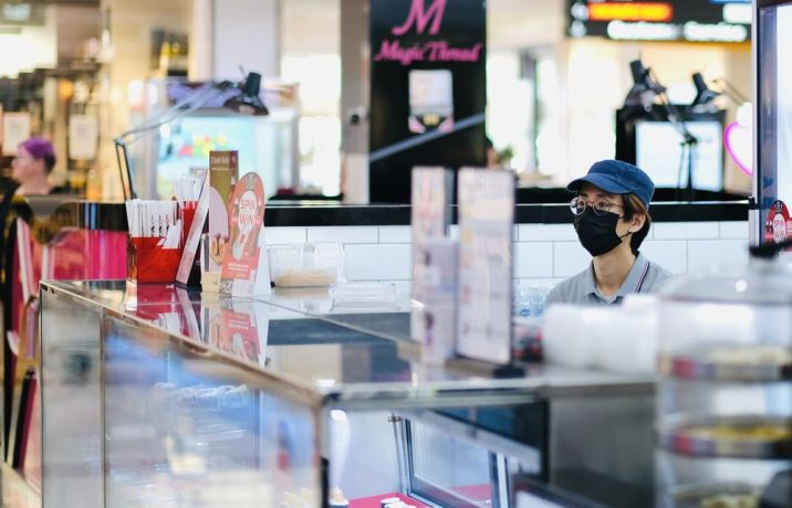 Australia: Shop assistant wears a mask to protect herself from COVID-19 in Queensland Australia shopping centre. More Info