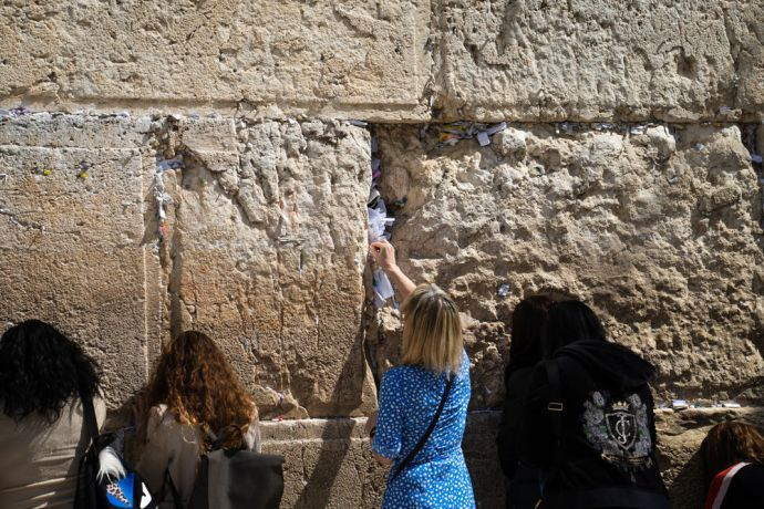 Israel: People praying at the wailing wall in Jerusalem. Photo by Rebecca Rempel. More Info