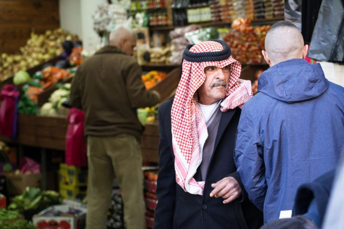 Israel: A man walks through the market. Photo by Rebecca Rempel. More Info