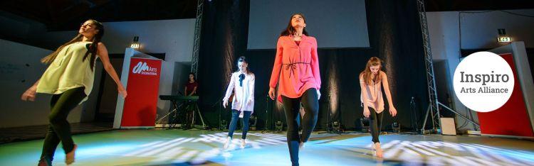 International: Inspiro Arts Alliance banner image_dancers - Photo by Garrett Nasrallah. More Info