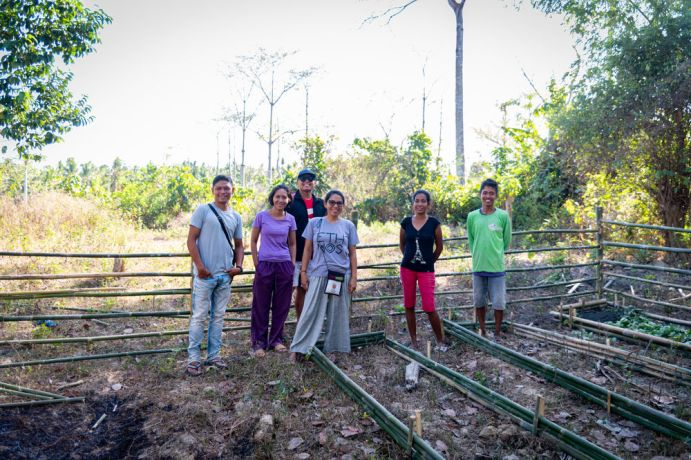 Philippines: Philip Lim visiting a family that the Palawan team trained in farming techniques. Photo by Alex Coleman. More Info