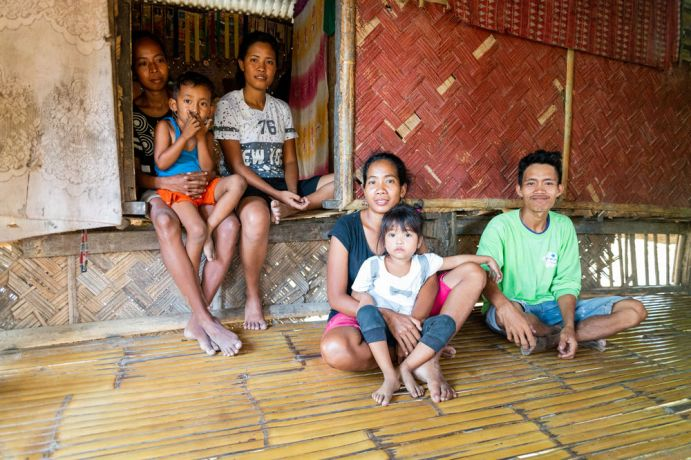 Philippines: The local team trains this tribal family in farming techniques and sponsors their eldest daughter to attend school. Photo by Alex Coleman. More Info