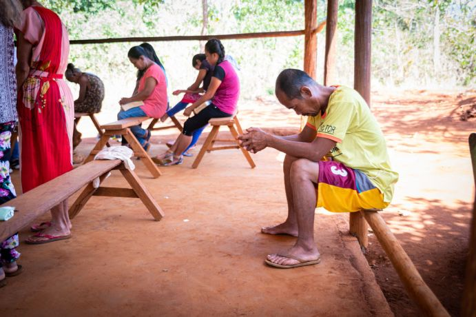 Philippines: A man praying at a tribal church in Palawan. Photo by Alex Coleman. More Info