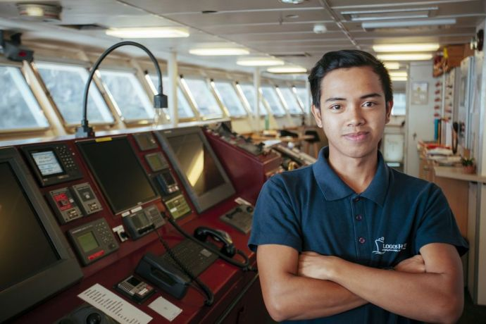 Jamaica: Kingston, Jamaica :: Deck crewmember Ezra William (East Asia Pacific) on the bridge of Logos Hope. More Info