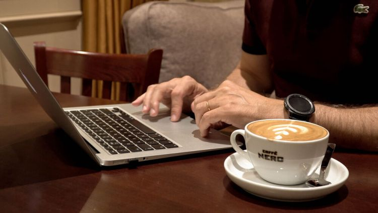 Arabian Peninsula: A marketplace worker spends the afternoon doing his job remotely at a local coffee shop. Photo by Jay S. More Info