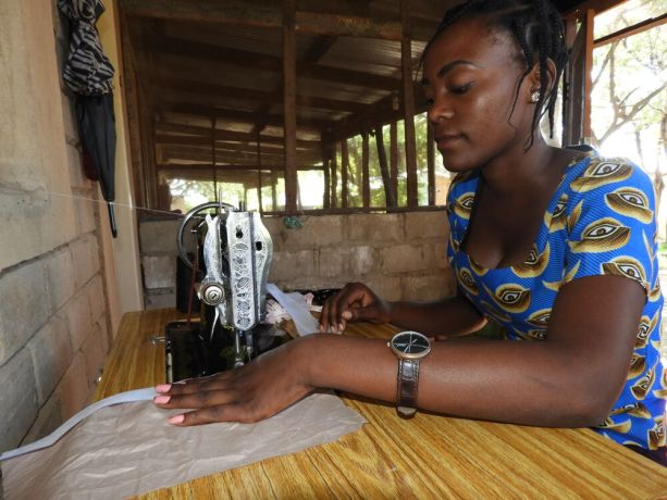 Zambia: Young woman sewing at Lake Tanganyika Hope House in Mpulungu, Zambia. Photo by Kennedy Mulenga. More Info
