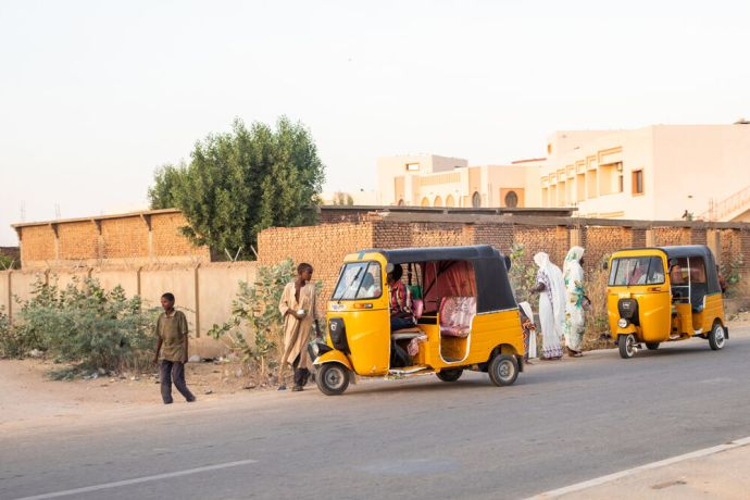 Africa: Locals using tuk-tuks in north-central Africa. Photo by Rebecca  R. More Info