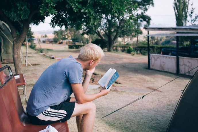 Lesotho: People reading the Bible in Lesotho. Lesotho is a small mountainous country completely surrounded by South Africa. Photo by Doseong Park. More Info
