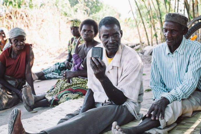 Malawi: People listen to scripture on an audioBible. The device is solar-powered and recites the Bible in their own language. Each person who has a device is encouraged to play it for others and thus spread the good news. Photo by Doseong Park. More Info
