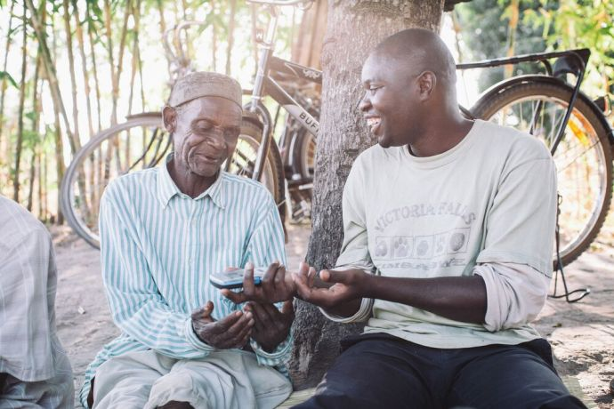 Malawi: Sharing the gospel with an audioBible. The device is solar-powered and recites the Bible in their own language. Each person who has a device is encouraged to play it for others and thus spread the good news. Photo by Doseong Park. More Info
