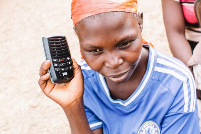 Malawi: Woman listening to scripture on an audioBible. The device is solar-powered and recites the Bible in their own language. Each person who has a device is encouraged to play it for others and thus spread the good news. Photo by Doseong Park. More Info